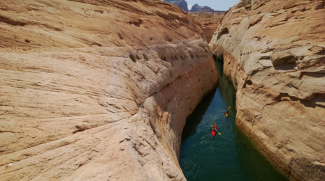 "alt=""Kayak ride through a Face canyon in Lake Powell"""
