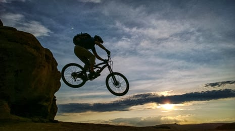 "alt=""Riding Moab's slick rock bicycle trail"""