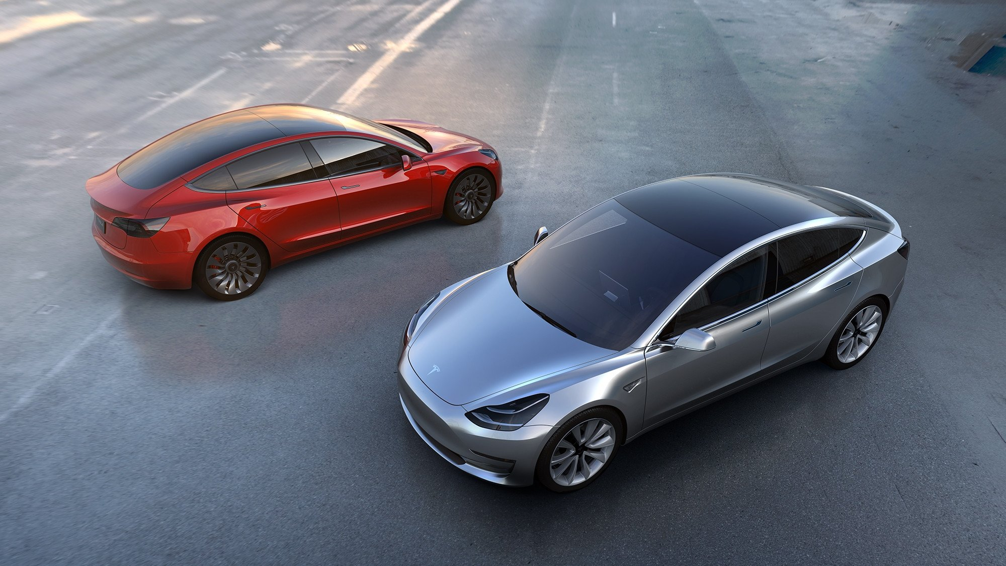 "alt=""Tesla"""